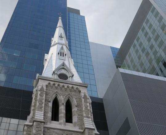 New buildings built around an old church