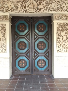 Colorful wooden door off the The House of Hospitality courtyard