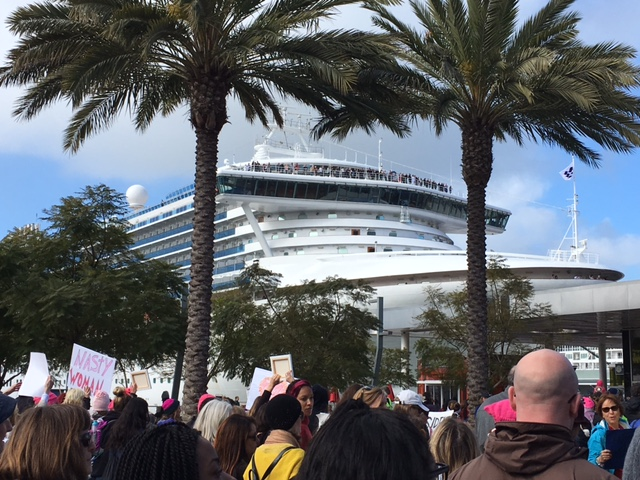 Travelers on a docked cruise ship watched and (some) cheered as we walked by.